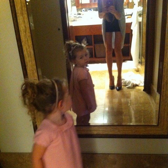 Doing a full circle, checking herself out in the mirror hahah so cute