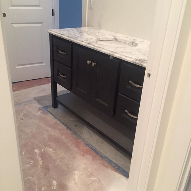 And the same quartzite on the dark cabinetry in the guest bath. I was worried about how it would look against the stain but it came out looking great!