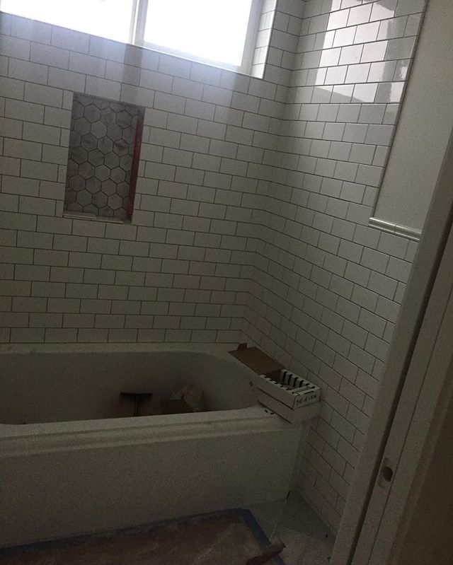 G's bath all tiled up with a wainscot. Can't wait to see how it will look when it's grouted.